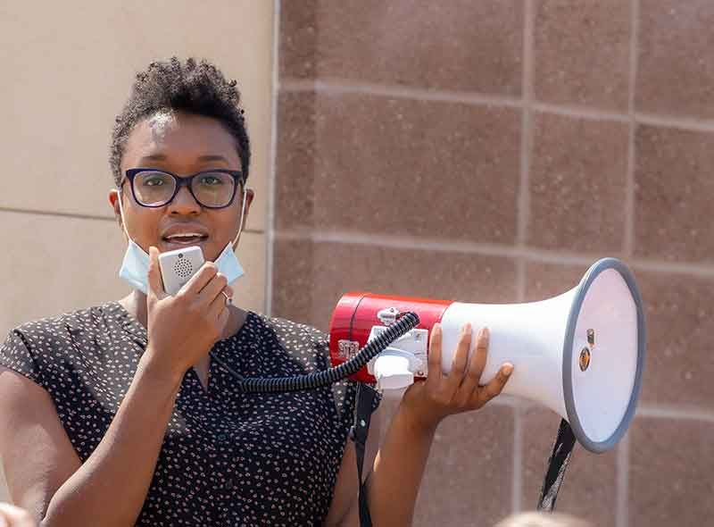 Dafina McMillan Speaking through a megaphone at a peaceful BLM protest
